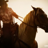 Cowboy Girl Riding Horse Into The Sunset