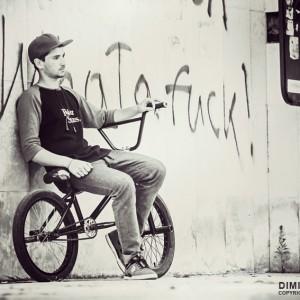 Portrait of the bicyclist sitting on BMX