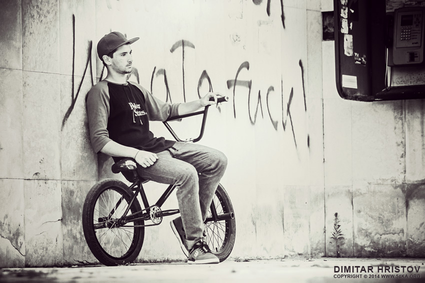 Portrait of the bicyclist sitting on BMX photography portraits black and white  Photo