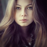 Young woman – soft sunny colors outdoor portrait