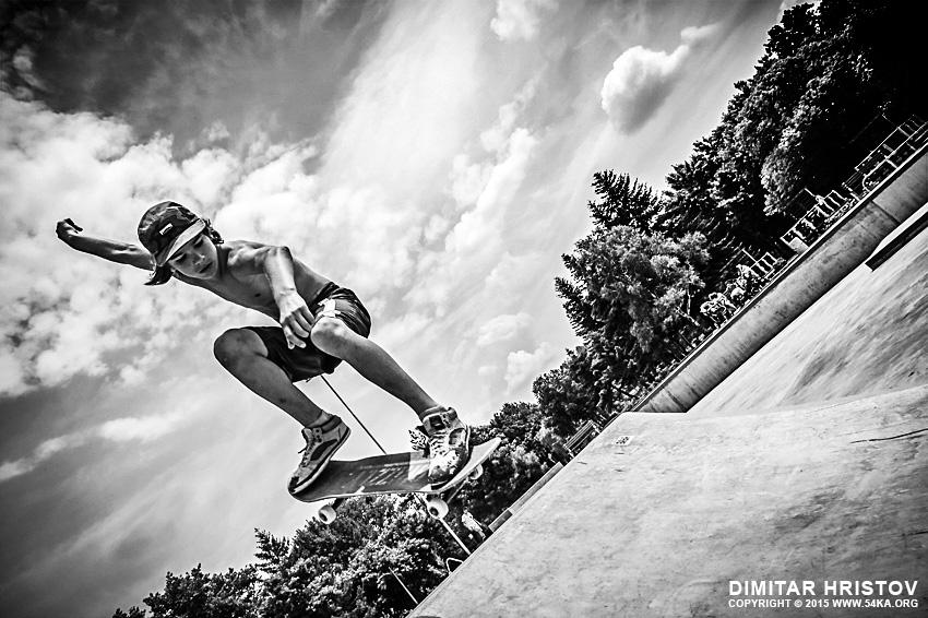 Boy with skateboard is going airborne photography other extreme black and white  Photo