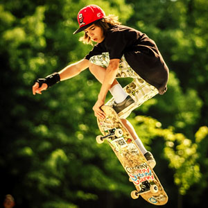 Boy skateboarding on stairs