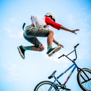 Young Boy Is Jumping With Bmx