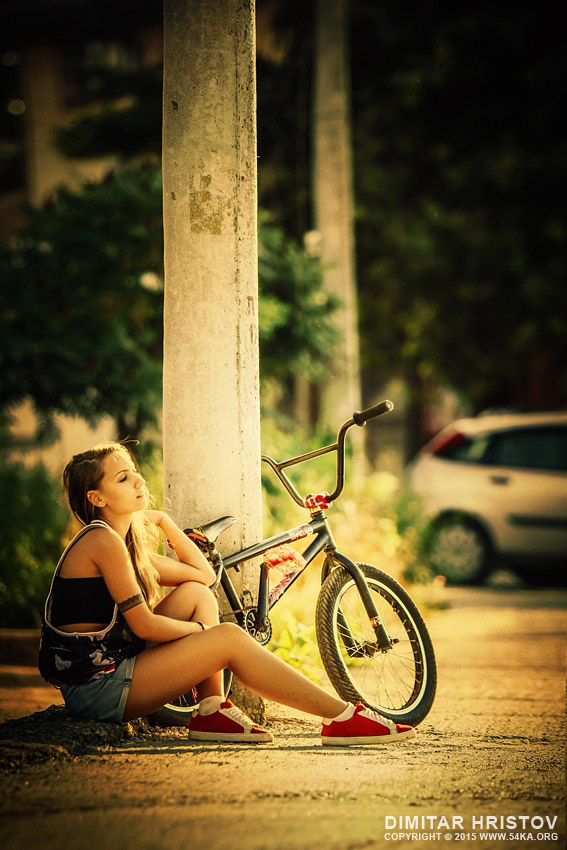 Young girl with bmx on the sunset street photography portraits  Photo