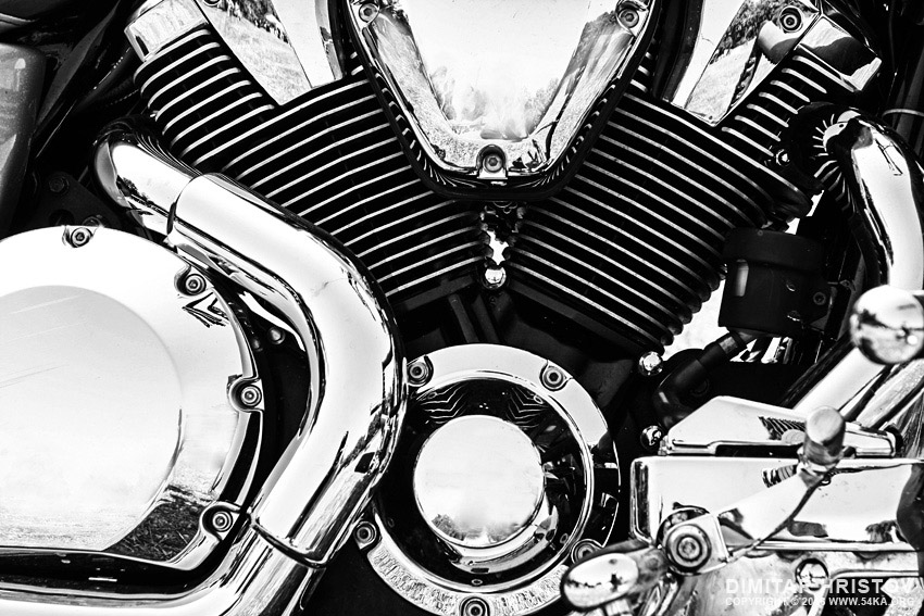 Chromed V Twin cylinder engine head on a Motorcycle photography other top rated featured black and white  Photo
