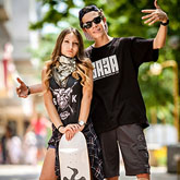 Boy ang girl with skateboard posing together – Young people urban lifestyle portrait