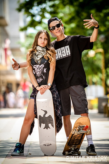 Boy ang girl with skateboard posing together   Young people urban lifestyle portrait photography portraits  Photo