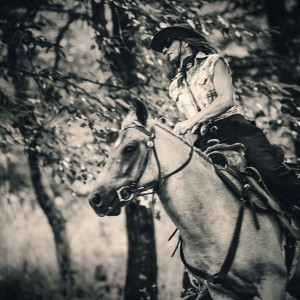 Cowgirl riding in the forest