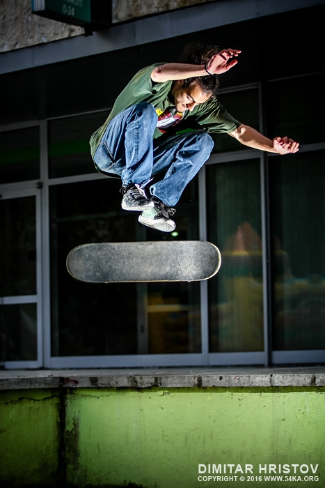 Skate boarder jump   board flipping photography extreme  Photo