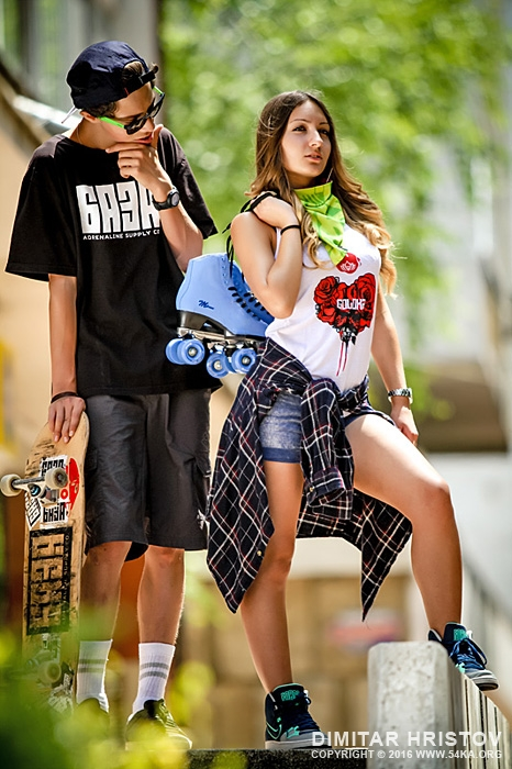 Teenage girl and boy with skateboards and roller skates outdoor portrait photography portraits fashion  Photo