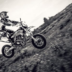 Biker making a stunt and jumps in the air