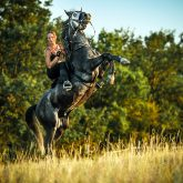 Girl riding rearing up horse