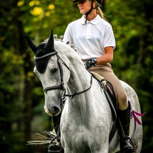 Girl riding white arabian horse
