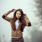 Young woman portrait in foggy morning