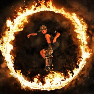 Skateboard jump in the Fire ring