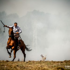 War horse and warrior galloping in the fire smoke