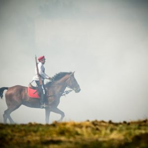 Cavalryman on a horse riding in a mist