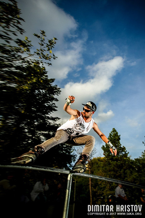 Aggressive inline roller blader grind on the rail photography extreme  Photo