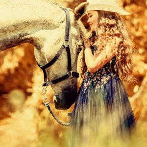Cute girl with beautiful white horse
