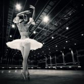 A beautiful ballerina dancing in studio