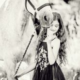Young Girl with beautiful white horse