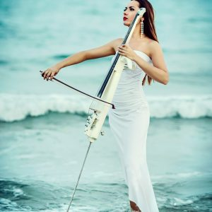 Woman playing cello in the sea