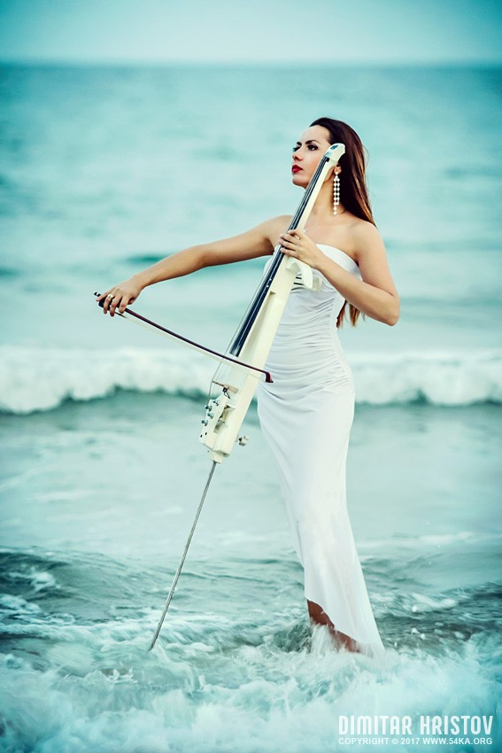 Woman playing cello in the sea photography portraits featured  Photo