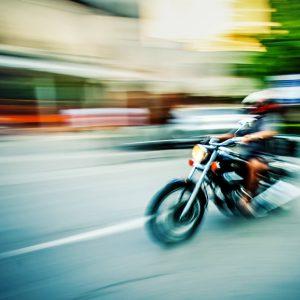 Biker riding motorbike – Abstract motion