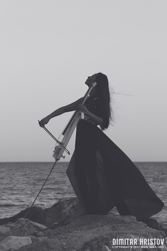 Woman with a cello on the coastline photography portraits featured black and white  Photo