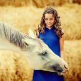 Happy girl with horse