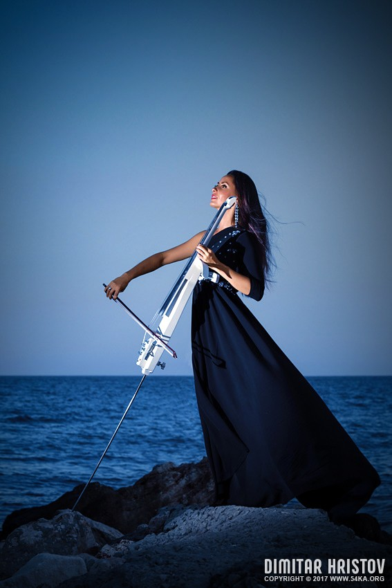 Beautiful woman playing cello on the sunset beach photography portraits featured  Photo