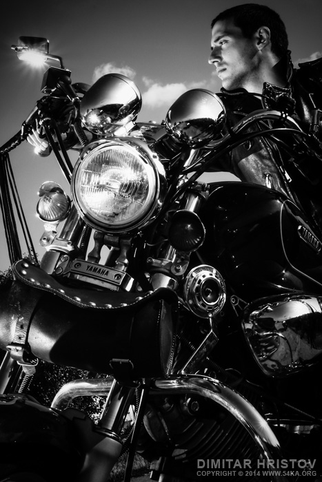 Biker riding a customized motorcycle photography portraits black and white  Photo