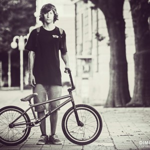 The young male bicyclist with BMX bicycle