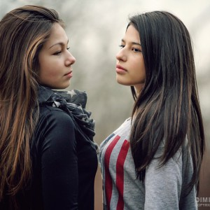 Outdoor portrait of two beautiful young girls