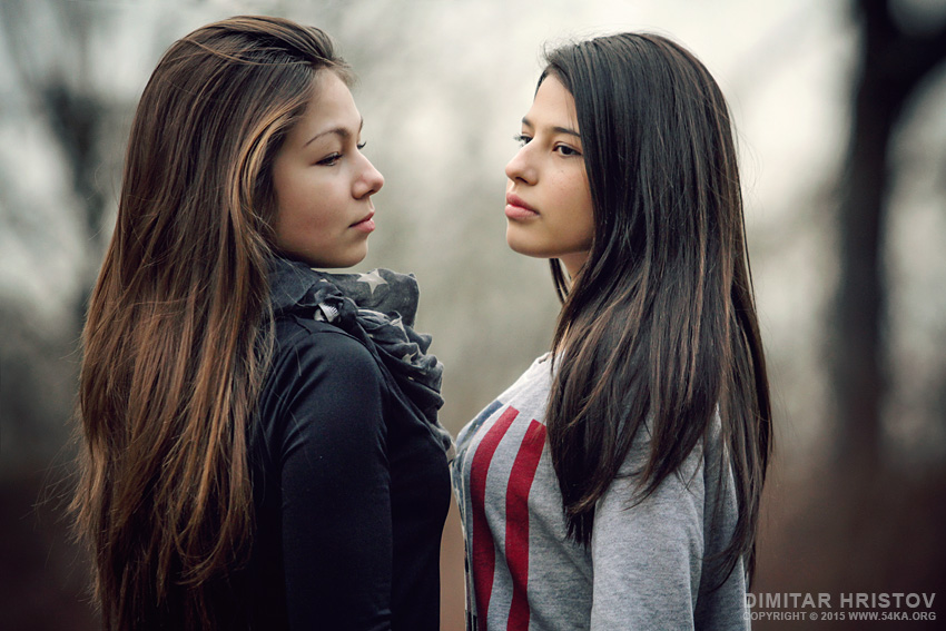 Outdoor portrait of two beautiful young girls photography portraits featured fashion  Photo