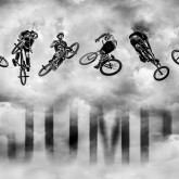 High BMX jump in a stormy sky