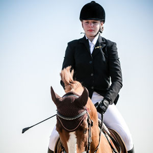 Young woman portrait – horse riding