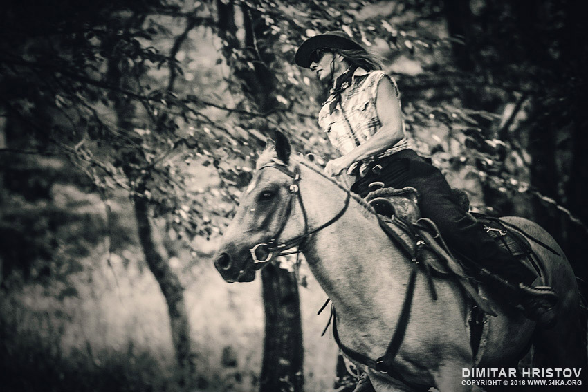 Cowgirl riding in the forest photography featured equine photography black and white animals  Photo