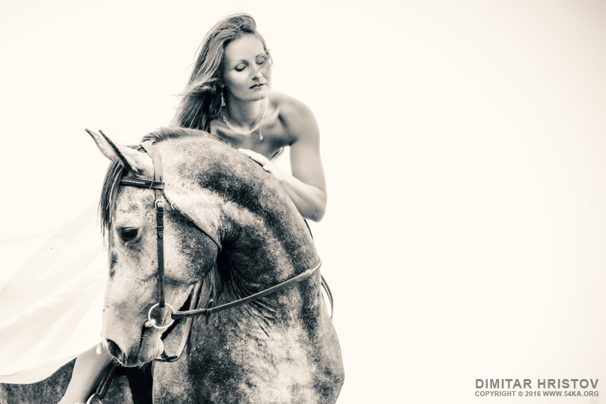 Beautiful woman in white dress and black horse portrait photography portraits featured equine photography black and white animals  Photo