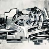 Boy riding skateboard in graffiti drawing pool