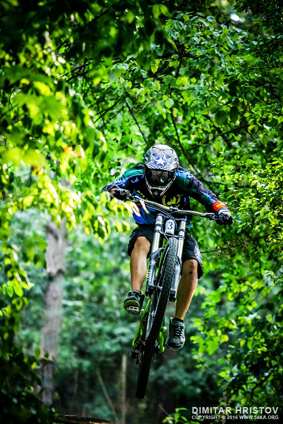 Mountainbiker rides jump in the forest photography extreme  Photo