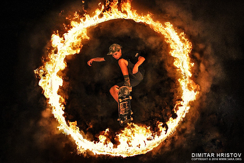 Skateboard jump in the Fire ring photography extreme  Photo