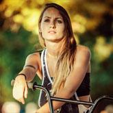 Young girl riding BMX bicycle