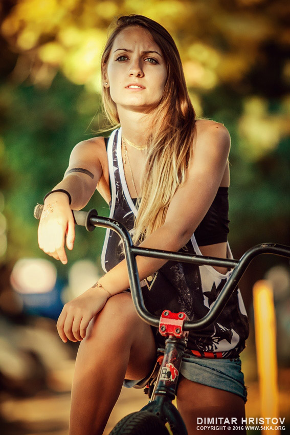 Young girl riding BMX bicycle photography portraits  Photo