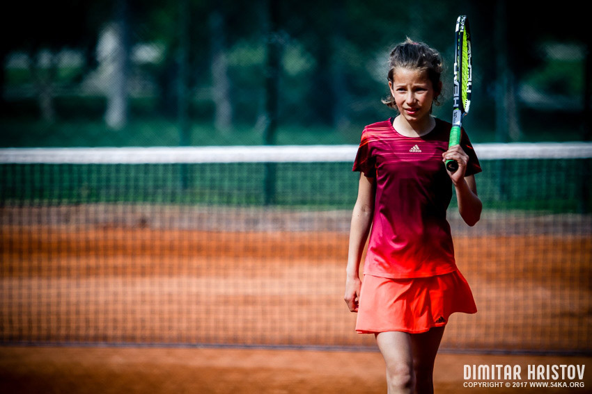 Young women playing tennis on the court daily dose  Photo