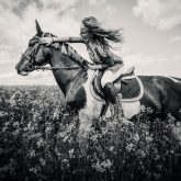 Horse riding in meadow – Girl portrait