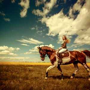 Girl riding horse on the beautiful landscape