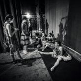Ballerinas sitting on the warm-up backstage