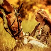 Girl and beautiful horse on autumn field