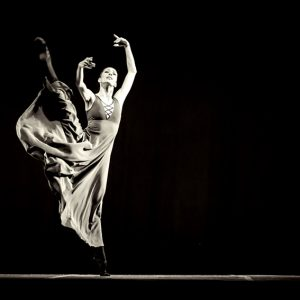 The beautiful ballerina dancing in long dress
